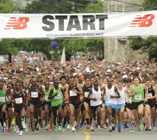 The 10,696 runners in the Falmouth Road race started 10 minutes late because shuttle buses were delayed by traffic.