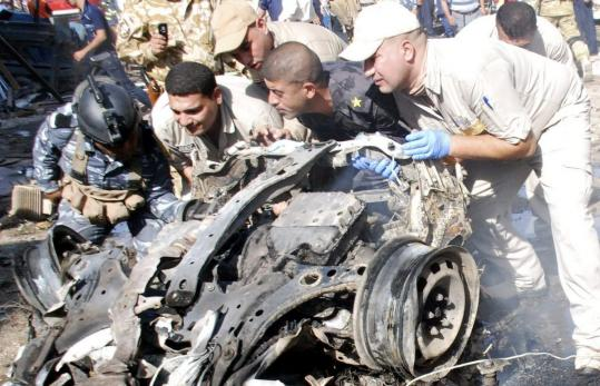 Security personnel (above) removed the remains of a vehicle used in an attack in the Iraqi city of Kut, where at least 35 people were killed when two bombs tore through a public square yesterday as part of an orchestrated series of attacks in the country. The wave of violence started early in the morning and spread through Iraq, with 42 attacks that killed at least 89 people. The attacks suggest that radical insurgents may have regained the capacity for the kind of violence that plagued Iraq at the height of the sectarian war in 2006 and 2007.
