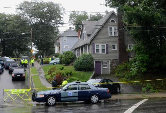 Police and Middlesex district attorney officials investigated the scene of a shooting on Lawrence Road in Reading yesterday.