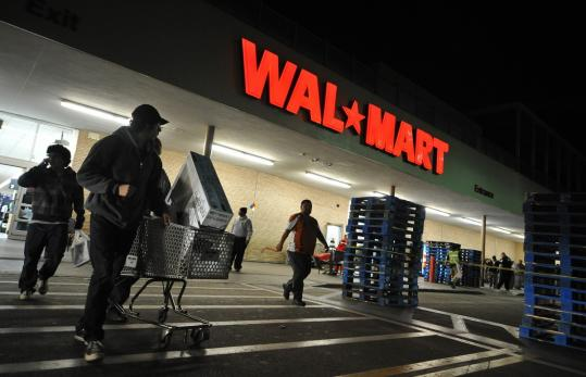 "Wal-Mart said same-store sales in the United States had declined, but the country's largest retail chain reported that net income had increased 5.7 percent because of what it called ""strong expense management,'' among other things."