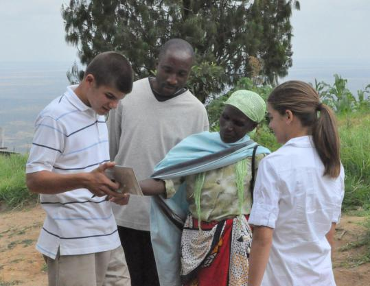 Lauren and Brian Triglione of Newburyport give an eye test to a woman at the Mrughua Dispensary in Bura, Kenya.