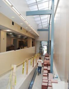 An atrium dedicated to the late Senator Edward M. Kennedy will connect the health center's old and new sections.
