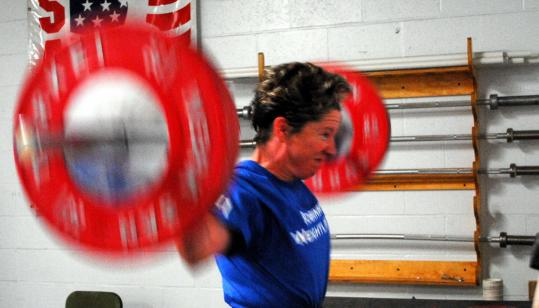 Bridgewater State University professor Ellyn M. Robinson isn't letting cancer stop her training.