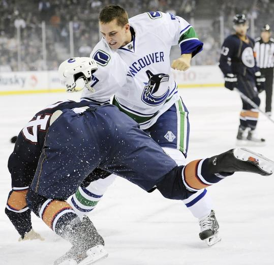 Rick Rypien fought with Edmonton's Zach Stortini in 2009.