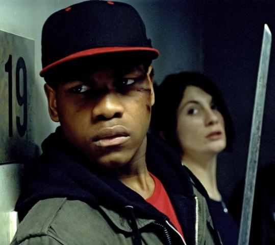 "John Boyega (left, with Jodie Whittaker) plays a young hood who tries to keep his crew from aliens in Joe Cornish's first directed film, ""Attack the Block.''"