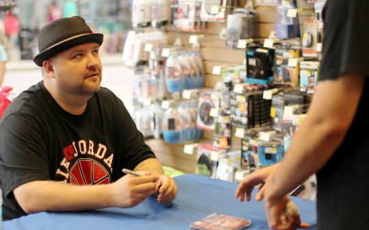 Slaine signing autographs at FYE at Downtown Crossing last night.
