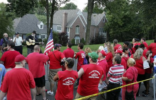 Striking Verizon workers held a candlelight vigil yesterday at the home of Verizon CEO Lowell McAdam in Mendham, N.J.