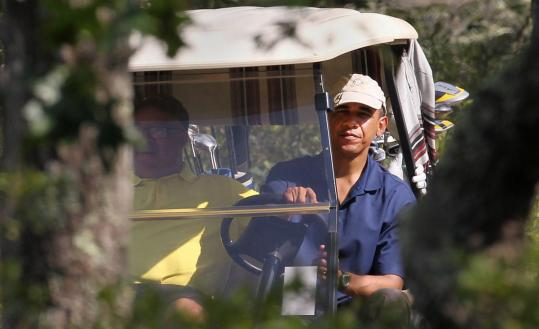 President Obama did his best to avoid photographers yesterday at the Vineyard Golf Course in Edgartown.