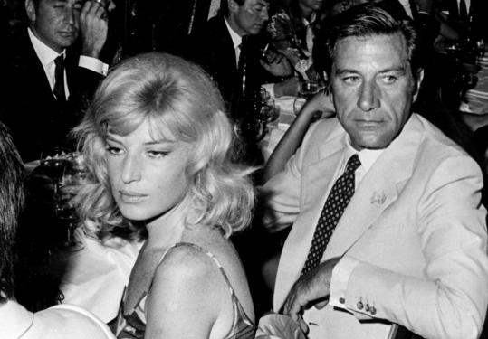 Gualtiero Jacopetti with actress Monica Vitti at a party in 1968.