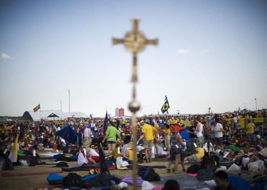 DAVID RAMON/GETTY IMAGES Pilgrims set up their camp in Madrid yesterday during a vigil as part of the World Youth Day festival, a celebration of the Catholic faith that is held every three years.