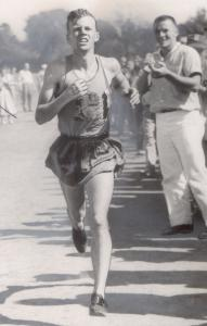 "John J. Kelley is shown competing in Needham and savoring his Boston Marathon victory with Johnny ""the Elder'' Kelley in 1957."