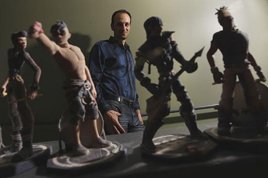 Alex Rigopulos, Harmonix cofounder, and a few of the company's Bandmates figurines.