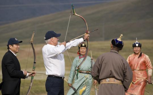 Vice President Joe Biden tried archery during his meeting with Prime Minister Sukhbaatar Batbold of Mongolia (left).