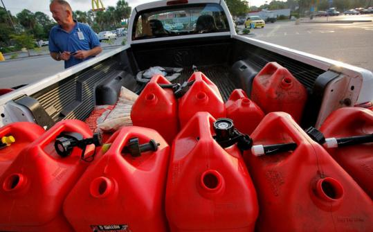 Resort landscaping manager Chris Jaeger filled his truck with 10-gallon gasoline containers yesterday in Garden City, S.C., to be prepared in case Irene hits the Myrtle Beach area.