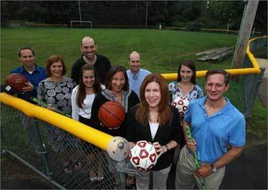 Jan Klein (holding soccer ball) and Yom Sport executive committee members at the Solomon Schecter Day Field School in Newton
