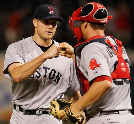 Jonathan Papelbon celebrates with catcher Ryan Lavarnway after the Red Sox put away the Rangers again last night.