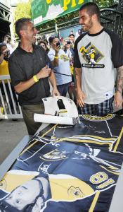 Bruins fan David Sachetti may have been seeing double as he got a Nathan Horton autograph at a charity softball game.