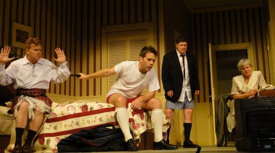 """From left: John Scherer, Jeremy Webb, Michael McGrath, and Suzanne Hay in Paul Slade Smith's """"Unnecessary Farce'' at the Cape Playhouse."""