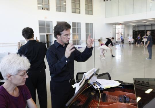 Music director Jonathan McPhee conducts a recent rehearsal at the Boston Ballet.