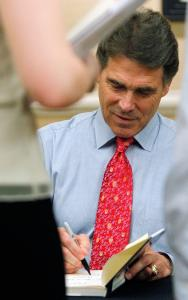 Analysts think Governor Rick Perry of Texas, signing his book for a supporter in Denver earlier this summer, is unlikely to hammer his GOP rival Mitt Romney on the health care issue.