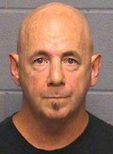 The DA said Thomas Donahue, 52, repeatedly asked the girl to stay after class to help him remove his leg brace.
