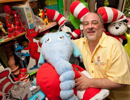 Charles Cohen, surrounded by Dr. Seuss collectibles in his South Deerfield home, brought attention to magazine stories the author had written in the 1950s.