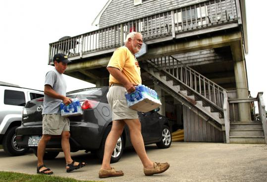 The National Weather Service expected the storm to hit Massachusetts hardest along the south coast and on the Cape and Islands. Byron Crampton (right), who stocked up on supplies with the help of his friend, Don Guzman, said his family would sit out Irene at their house on Crescent Beach in Mattapoisett.