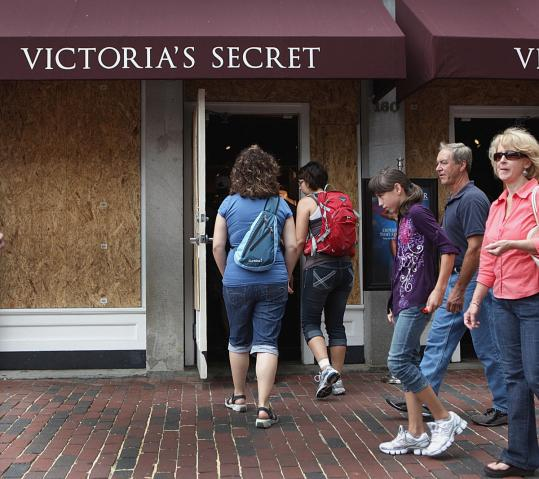 The Victoria's Secret shop at Faneuil Hall boarded up its storefront in anticipation of the storm, but was open for business yesterday. Many malls and businesses planned to close today.