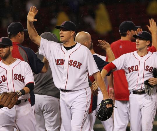 Jonathan Papelbon set the A's down in the ninth, then celebrated the 4-0 nightcap victory.