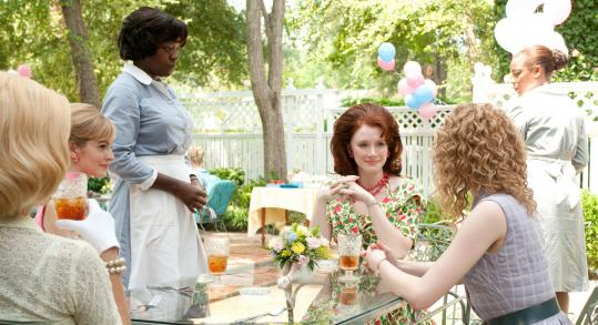 "Viola Davis (standing) plays one of the Southern maids at the center of ""The Help,'' which has been the No. 1 film for two consecutive weekends."
