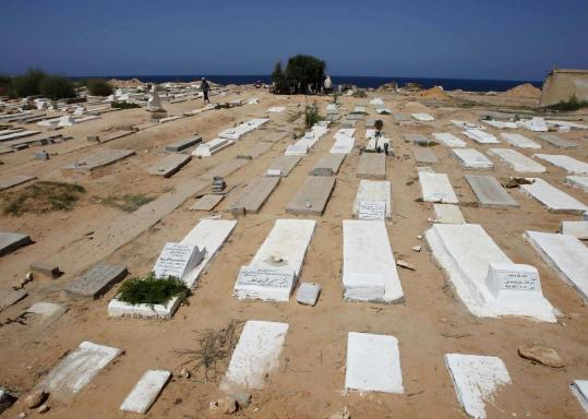 Corpses found in Tripoli after a week of fierce fighting between Libyan rebels and Khadafy forces were buried in this cemetery. Some bodies are still being retrieved from the city's streets.