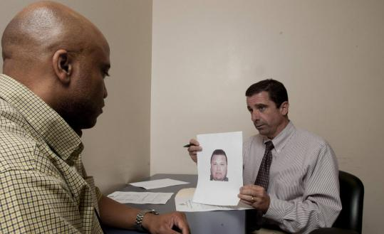 Dallas Police homicide detectives Chris Daniels (left) and David Pughes presented a sequential photo lineup method.