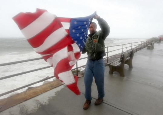 """During troubled times, you can always count on the flag,'' said Richard Tarter, a former Marine, yesterday in Oak Bluffs. Tarter said the country's colors should always fly, ""no matter what.'' In similar fashion, he had unfurled the Stars and Stripes 20 years ago during Hurricane Bob, too."
