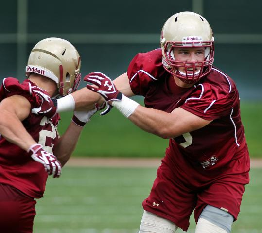 Luke Kuechly sheds a blocker at practice; he made 341 tackles during his first two seasons at BC.