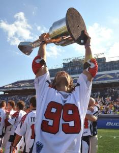 Paul Rabil, the MLL MVP, shows off the championship hardware after the Cannons knocked off the Nationals, 10-9.