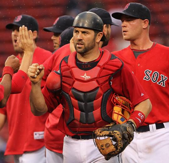 Jason Varitek was front and center in the Red Sox' win in Game 1 of a doubleheader Saturday.