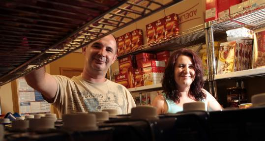 Edin and Elma Custovic at Elma, which carries 1,500 products from Bosnia, Croatia, Slovenia, and other European countries including traditional breads, cream spreads, and sausages.