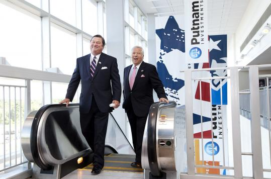 Robert Reynolds (left), Putnam Investments chief executive, and New England Patriots owner Robert Kraft were on a media tour of the Putnam Club at Gillette Stadium in Foxborough.