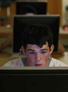 Hopkinton High football player J.R. Barnes, 16, takes a computer test to be used as a baseline in case he gets a concussion. The testing is part of an effort to prevent long-term brain injuries stemming from high-impact collisions in football and other sports.
