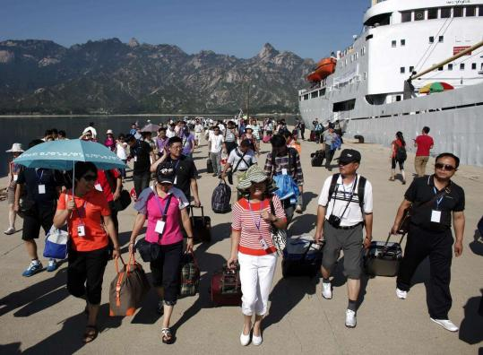 North Korea hosted the first shipload of passengers from China yesterday at a resort it once shared with South Korea.