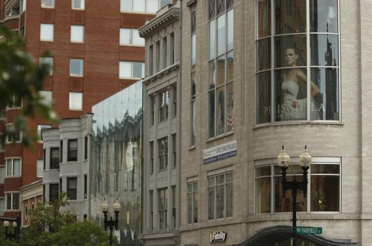 Priscilla of Boston, on Boylston Street, is seen as the posh older sister to the less expensive David's Bridal.