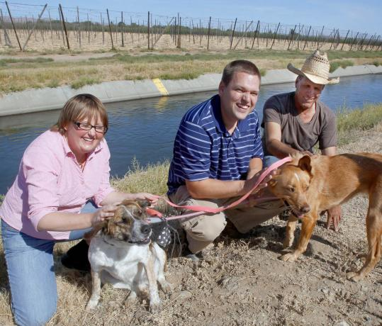 Jesus Villanueva (right) rescued two dogs, Nia and Fawn, owned by Noya (left) and Matt Deats .