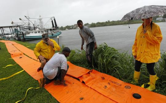 Workers prepared for Tropical Storm Lee yesterday in Jean Lafitte, La., near New Orleans, by preparing a temporary dam.