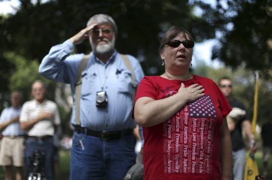 Supporters attended a Tea Party Express rally in Iowa Thursday. A conservative advocacy group plans to protest Mitt Romney&#8217;s scheduled appearance at Tea Party Express rally tomorrow .