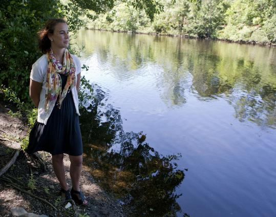 Jennifer Ross, standing in an area along the Charles River in Watertown being targeted for revitalization, was hired to coordinate the effort.