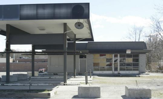 The abandoned, boarded-up gas station on Edgell Road next to Nobscot Shopping Center.