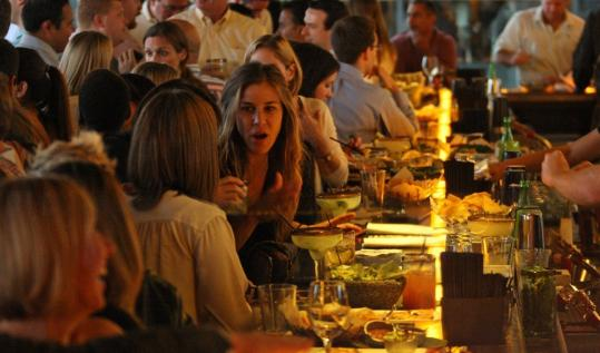 The bar at Temazcal Tequila Cantina, a gourmet Mexican bistro, was packed on Friday night.