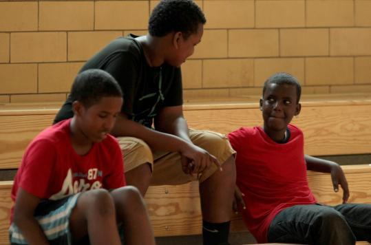 Dahir Hersi, 12, (left), and Mahdi Ali, 15, both of Boston, and Mohamed Hassan, 13, of Quincy, participated in a basketball tournament at the Tobin Community Center in Roxbury yesterday.