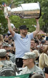 CUP OF CHEER - Bruins goalie Tim Thomas was a big hit yesterday when he brought the Stanley Cup to Burlington, Vt., where he went to college.