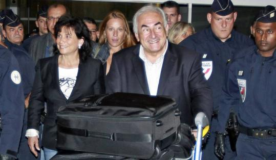 Dominique Strauss-Kahn and his wife, Anne Sinclair, arrived in France yesterday for the first time since the former IMF chief was accused of attempted rape in May.